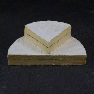 CheeseShop Over the Moon Dairy Black Truffle Brie cut fresh
